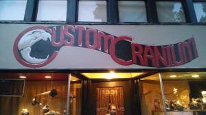 Custom Cranium storefront. Sign art by Stephan Maich, photo by Darien.